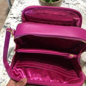 Sling bag with multiple compartments.